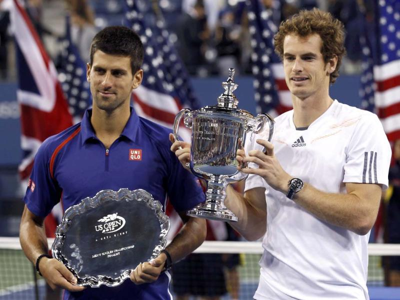 Britain's Andy Murray and Serbia's Novak Djokovic hold their trophies after Murray defeated Djokovic in the men's singles final match at the US Open tennis tournament in New York. (Reuters/Kevin Lamarque)