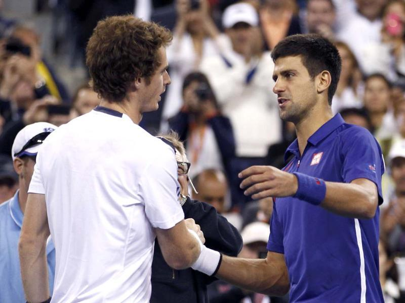Britain's Andy Murray shakes hands with Serbia's Novak Djokovic after defeating him in the men's singles final match at the US Open tennis tournament in New York. (Reuters/Adam Hunger)