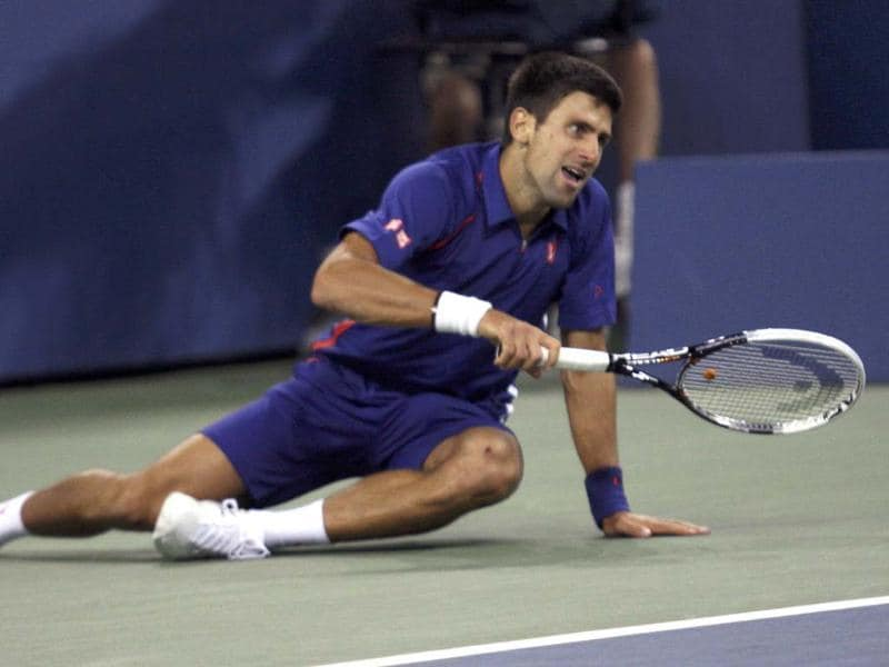 Serbia's Novak Djokovic falls during the men's singles final match against Britain's Andy Murray at the US Open tennis tournament in New York. (Reuters/Eduardo Munoz)