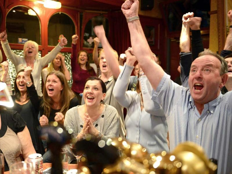 Fans of tennis player Andy Murray react as he wins his US Open men's singles final match, at the bar of The Dunblane Hotel in his hometown in Dunblane, Scotland. (Reuters/Russell Cheyne)