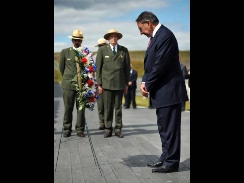 US defense secretary Leon Panetta crosses himself after laying a wreath at the Flight 93 national memorial during ceremonies commemorating the 11th anniversary of the 9/11 attacks in Shanksville, Pennsylvania. (AFP/Mandel Ngan)
