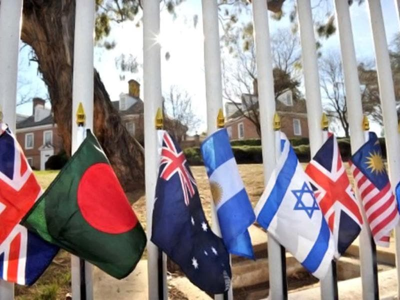 Flags adorn the fence of the US embassy in the Australian capital Canberra to commemorate the 11th anniversary of the September 11, 2001 attacks in the US, with a flag for each country that had a victim in the attacks. AFP