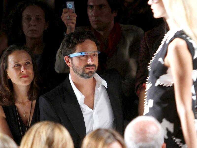 Google founder Sergey Brin (R) and a guest watch the the Diane von Furstenberg Spring/Summer 2013 collection show during New York Fashion Week September 9, 2012. The show was used as a launching event for Google's new product
