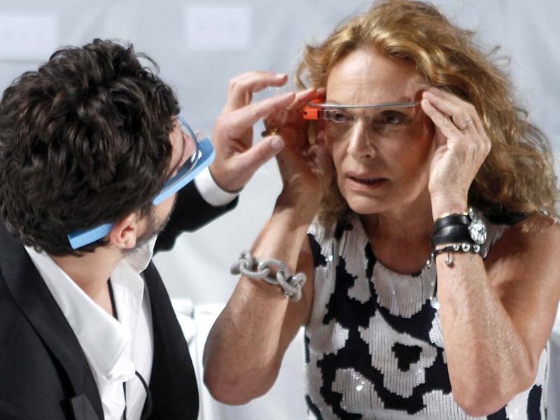 Google founder Sergey Brin (L) adjusts a pair of Project Glass glasses on designer Diane von Furstenberg before the rehearsal for von Furstenberg's Spring/Summer 2013 collection show during New York Fashion Week September 9, 2012. The show was used as a launching event for Google's