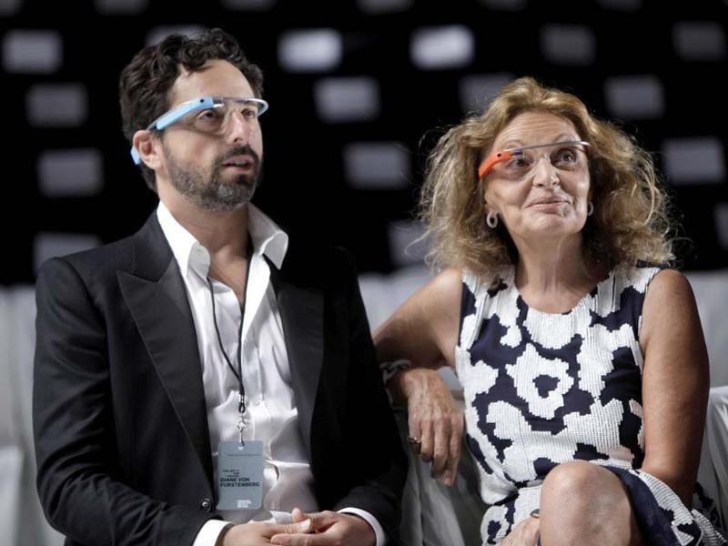 Diane Von Furstenberg watches a practice run of her Spring 2013 show with Google co-founder Sergey Brin during Fashion Week in New York, Sunday, Sept. 9, 2012. Both are wearing Google Glass, headwear that contains electronics such as a computer processor and a camera. (AP Photo/Seth Wenig)