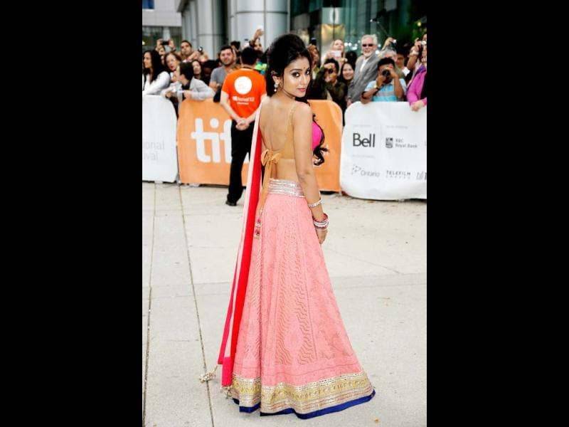 Actor Shriya Saran brings sexy back during the 37th Toronto International Film Festival. She was a delight for the cameras in a glamourous pink lehanga-choli and her playful demeanour.