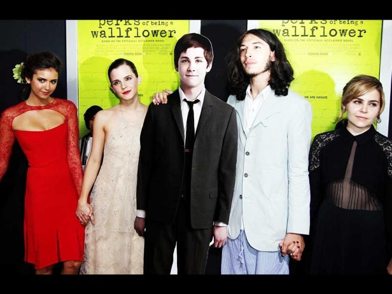Watson was seen in a nude gown as she posed with the cast of The Perks of Being a Wallflower, including the cutout of the absent Logan Lerman.