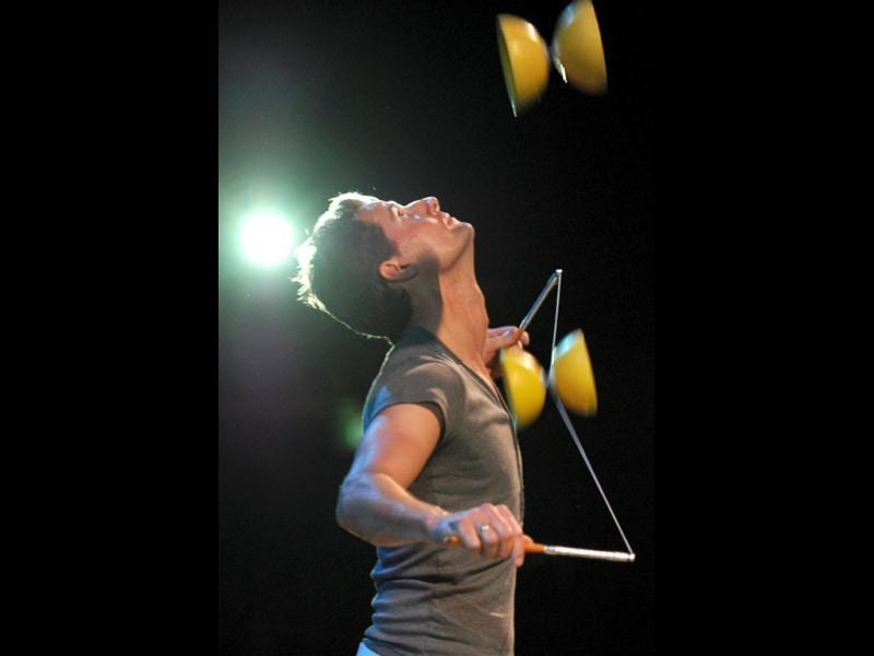 A performer of the world famous trouple Cirque du Soleil practices his juggling routine in the big top tent in Sydney. Cirque du Soleil takes the audience into the diverse and colorful world of insects in their show that made its debut in Montreal. (AFP Photo)