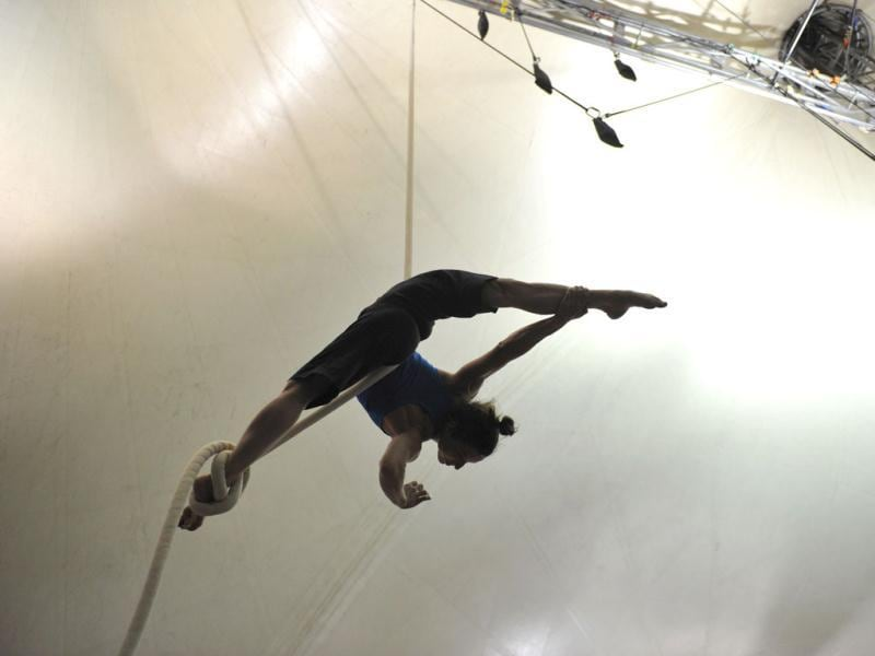 Svitlana Kashevarova, a performer with the world famous troupe Cirque du Soleil, practices her acrobatic routine on a suspended rope at the backstage big top tent in Sydney. (AFP Photo)