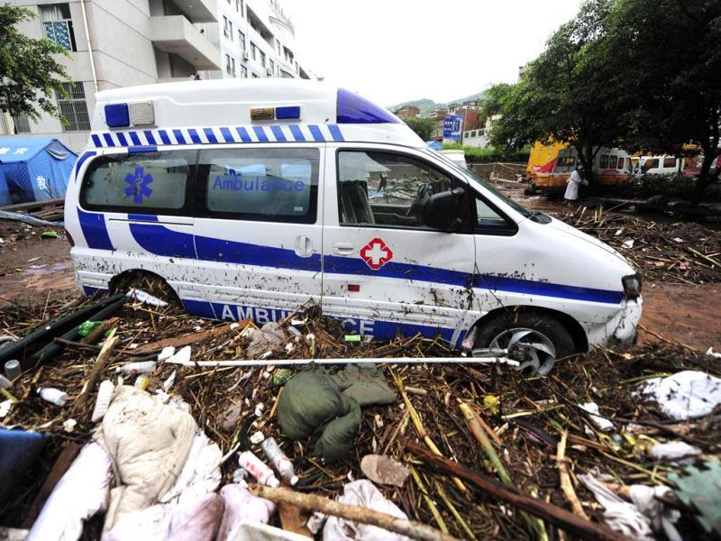 This picture shows an ambulance surrounded by mud and debris after torrential rains swept quake-hit Yiliang, in southwest China's Yunnan province, causing flooding and mudslides. (AFP)