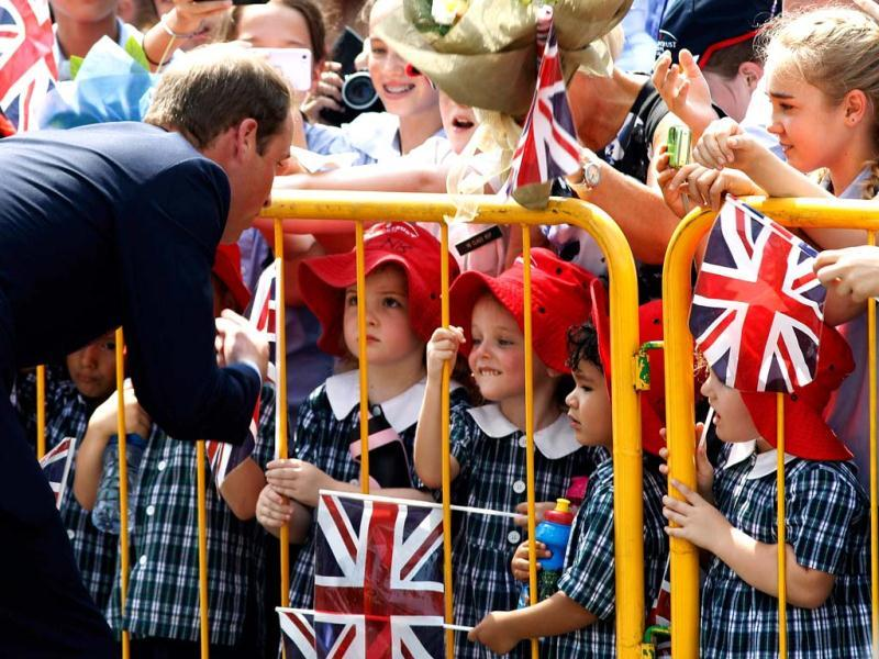 Britain's Prince William greets young fans at Gardens by the Bay during his visit to Singapore. (AFP/Edgar Su)