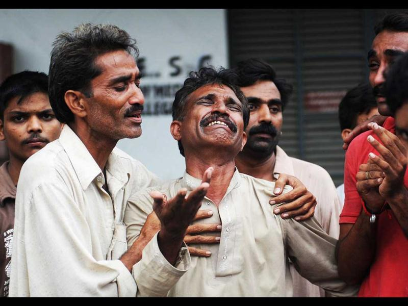 A Pakistani man mourns the death of relatives after a fire erupted in a garment factory in Karachi. (AFP/Asif Hassan)
