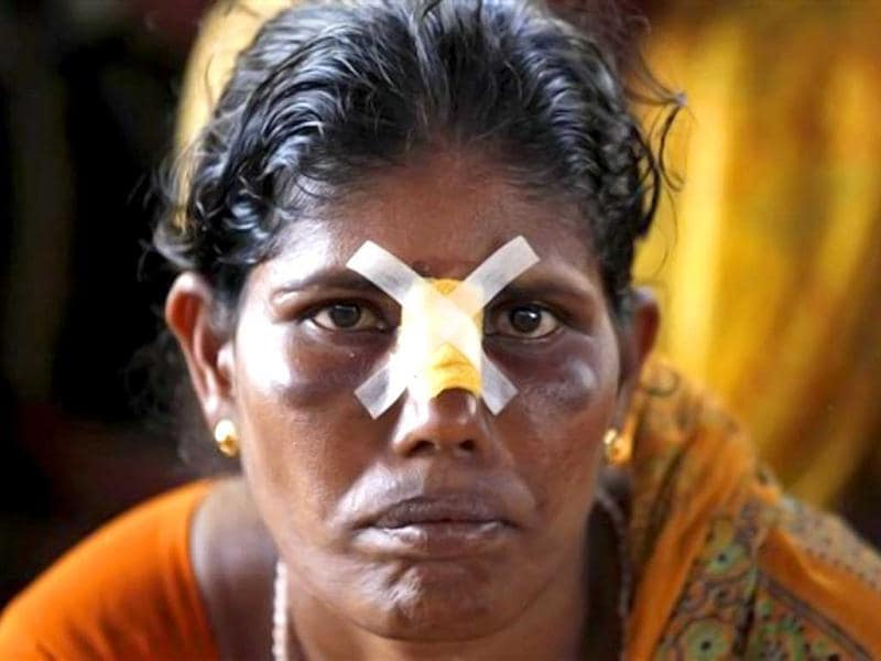 India is struggling to meet surging demand for electricity and suffers from a peak-hour power deficit of about 12 percent, which has become a significant drag on the economy. A grid failure on two consecutive days this summer caused one of the world's worst blackouts. In this picture, protestor Gita Malla sits with a dressing on her nose after being injured in a protestagainst the Kudankulam Atomic Power Project. Centre justified Tamil Nadu government's decision to stamp out protests for the plant's safety and termed the protest as illegal as High Court has cleared the plant. (AP Photo/Rafiq Maqbool)
