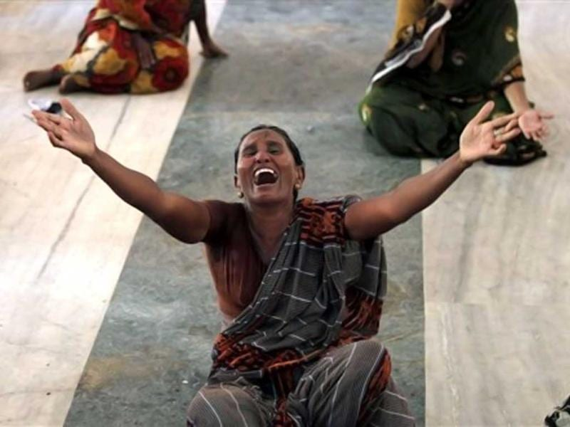 Woman wails during a protest against the Kudankulam Atomic Power Project, near the project site. Anti Kudankulam protestors slammed safety report, charging it with hiding crucial information from people. (AP Photo/Rafiq Maqbool)