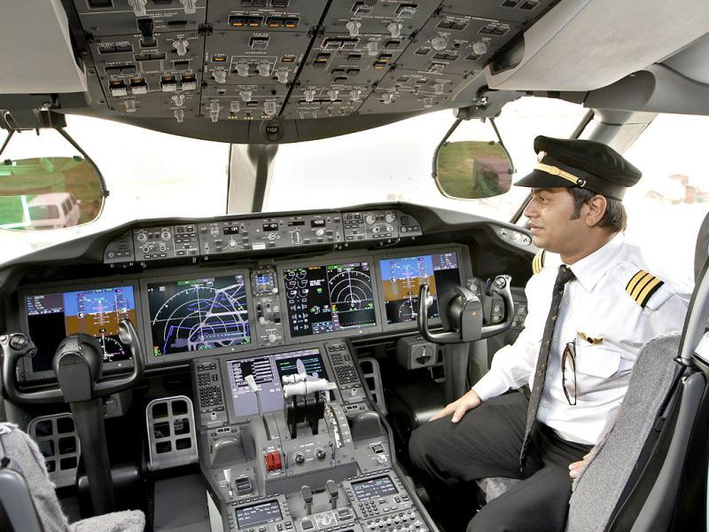 A Air India pilot poses inside the cockpit of a Boeing 787 Dreamliner. HT/Sanjeev Verma