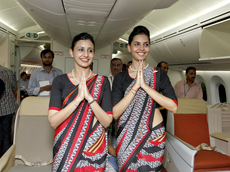 Air India flight attendants welcome media person during the unveiling of Air India's first Boeing 787 Dreamliner. HT/Sanjeev Verma