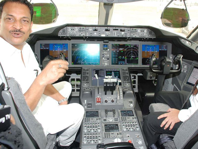 Former civil aviation minister Rajeev Pratap Rudy is seen inside the cockpit of the newly inducted Boeing 787 Dreamliner. UNI