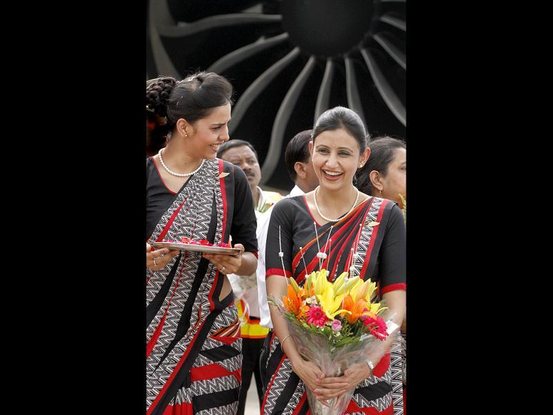 Air India flight attendants are seen during the unveiling of Air India's first Boeing 787 Dreamliner. HT/Sanjeev Verma