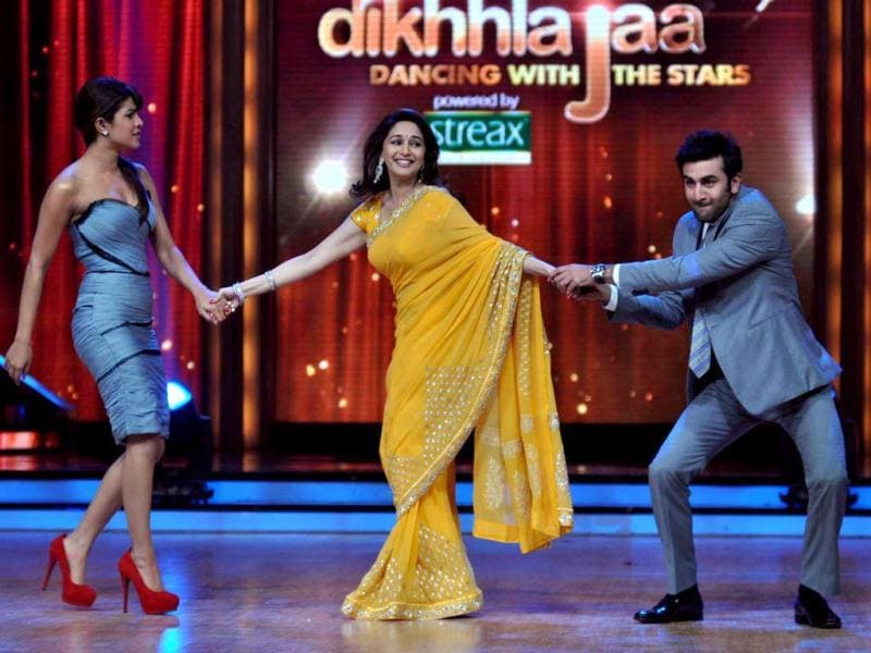 Tug of war: Priyanka Chopra and Ranbir Kapoor pull Madhuri Dixit on their respective sides. (Photo: AFP)
