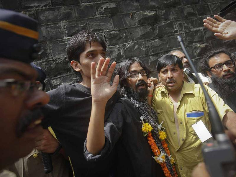Cartoonist Aseem Trivedi waves after coming out of Arthur Road Jail in Mumbai. Reuters Photo