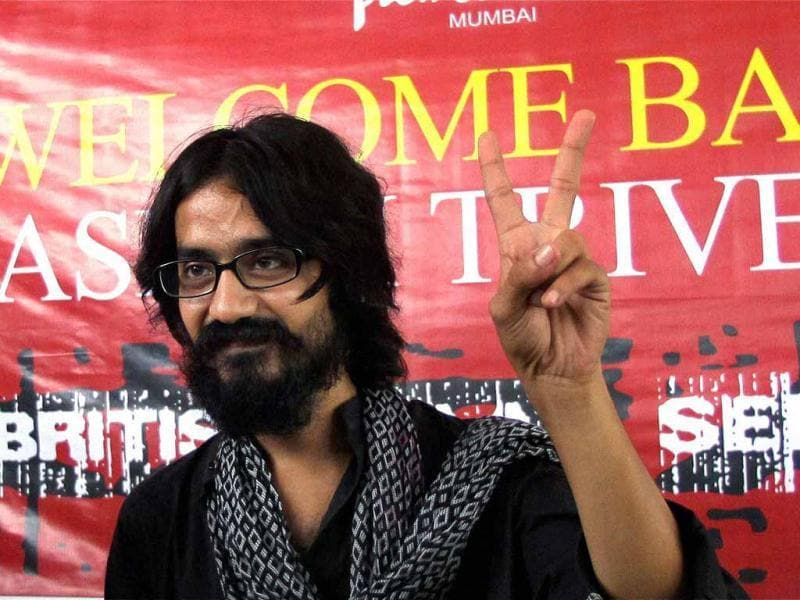 Cartoonist Aseem Trivedi flashes victory sign during a press conference after he was released on bail in Mumbai. PTI Photo