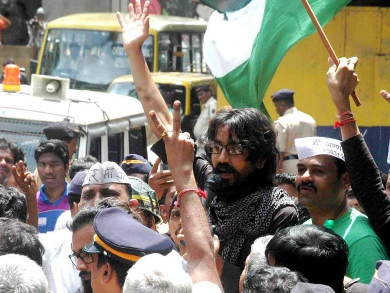 Cartoonist Aseem Trivedi who was arrested on sedition charges, waves after release from the Arthur Road jail in Mumbai. Agencies