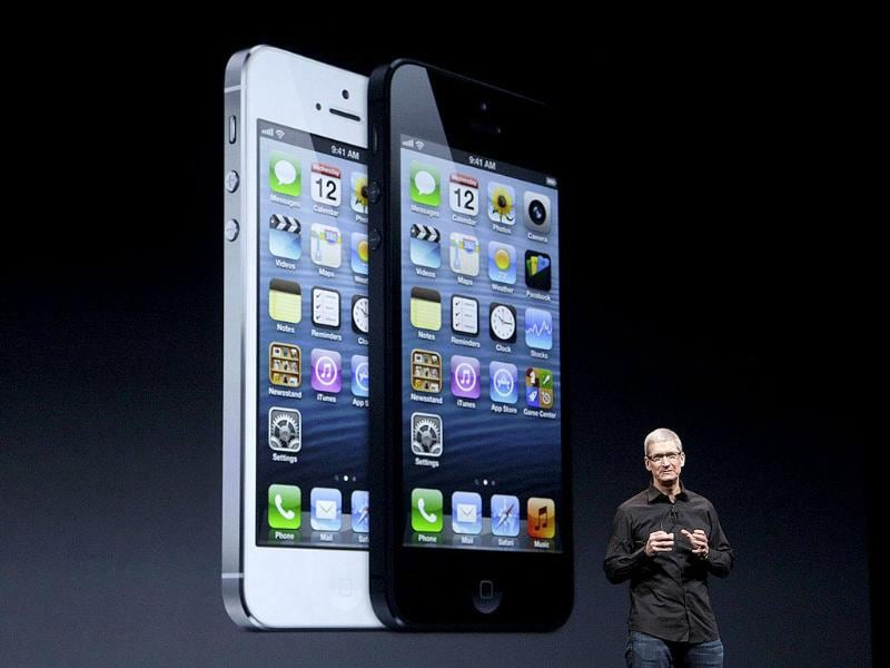Apple CEO Tim Cook introduces the iPhone 5 - a lighter, thinner and more powerful version of its iconic mobile device, staking its claim to leadership in the red-hot smartphone market. AP Photo