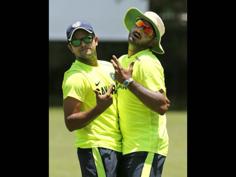 Suresh Raina and Harbhajan Singh playfully pose for photographs during a practice session ahead of the Twenty20 World Cup cricket tournament in Colombo, Sri Lanka. AP Photo/Eranga Jayawardena