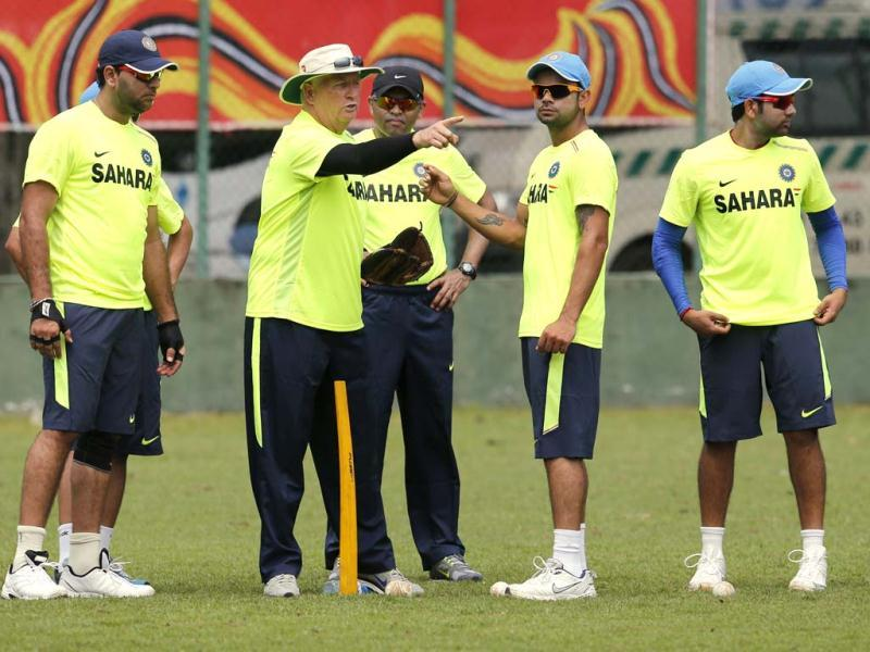 Coach Duncan Fletcher, second left, gestures during a practice session ahead of the Twenty20 World Cup tournament in Colombo, Sri Lanka. AP Photo/Eranga Jayawardena