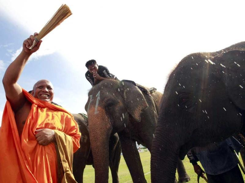 A Buddhist monk blesses elephants during the opening the the 11th King's Cup Elephant Polo Tournament in the resort town of Hua-Hin, some 160 km (99 miles) south of Bangkok. Reuters photo/Sukree Sukplang