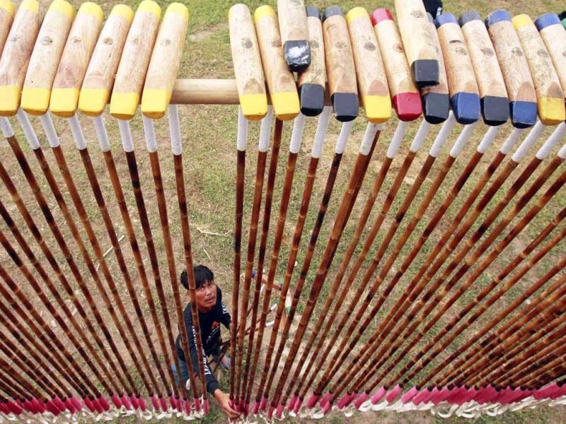 A mahout checks polo mallets before a match during the 11th King's Cup Elephant Polo Tournament in the resort town of Hua-Hin, some 160 km (99 miles) south of Bangkok. Reuters photo/Sukree Sukplang