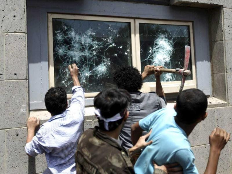 Protesters break windows at the US embassy in Sanaa. Hundreds of Yemeni demonstrators stormed the US embassy in Sanaa in protest against a film they consider blasphemous to Islam, and security guards tried to hold them off by firing into the air.REUTERS
