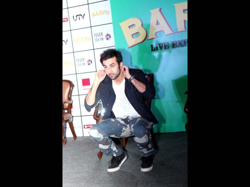 Apologising for something? Ranbir Kapoor doing situps at the Barfi! promotions.