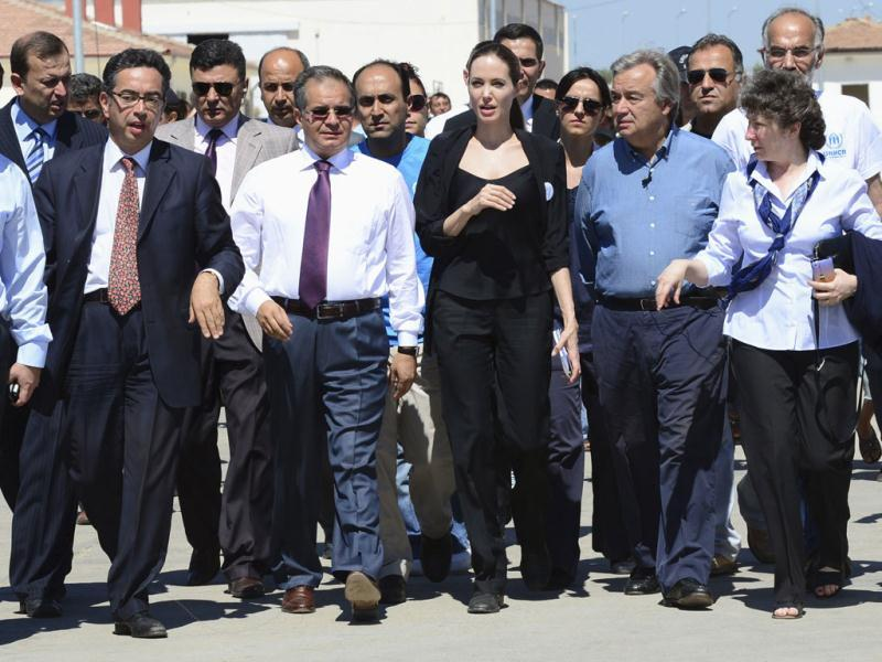 Angelina Jolie walks with officials during her visit to a camp to meet Syrian refugees in the southeastern Turkish city. (Reuters Photo)