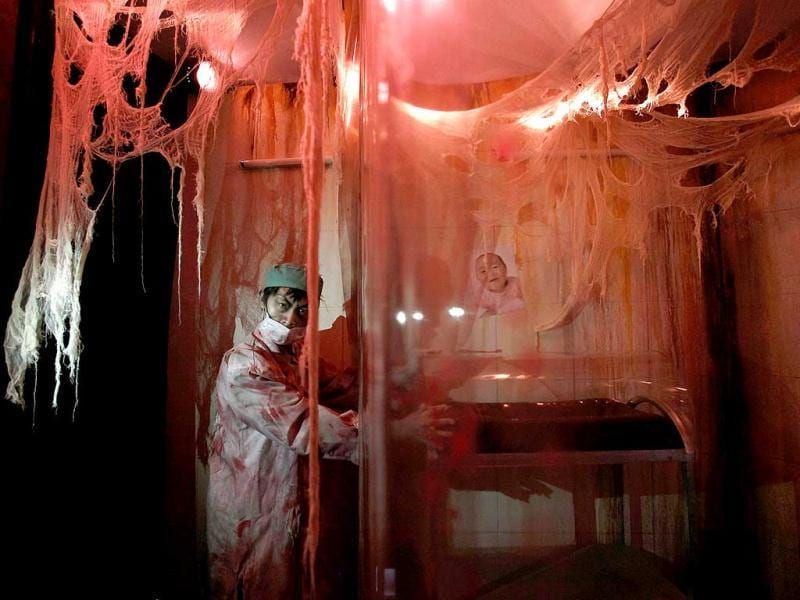 An actor dressed as a ghost doctor inside a 5D haunted house at the Hong Kong Ocean Park. Reuters Photo