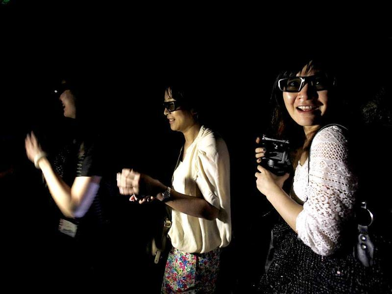 Visitors react while watching a projection with 3D glasses inside a 5D haunted house at the Hong Kong Ocean Park. Reuters Photo