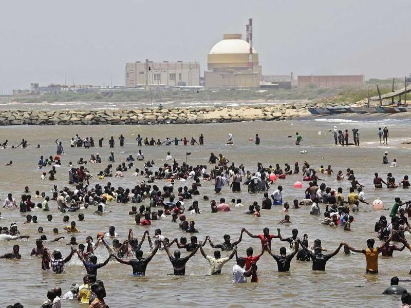 Demonstrators stand in the waters of the Bay of Bengal as they shout slogans during a protest near the Kudankulam nuclear power project in Tamil Nadu. Reuters/Adnan Abidi