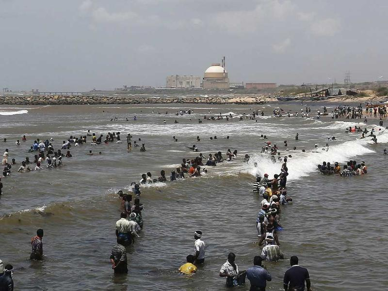 Demonstrators stand in the waters of the Bay of Bengal during a protest near Kudankulam nuclear power project in Tamil Nadu. Demonstrators are protesting against the country's largest nuclear power project, over fears about the plant's safety. Reuters/Adnan Abidi