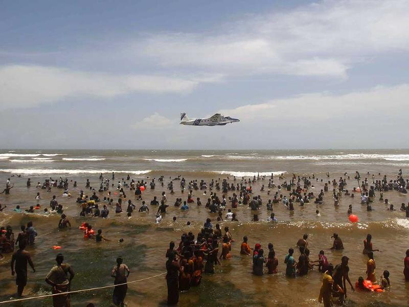 A Coast Guard aircraft flies over activists and residents standing in the waters of the Bay of Bengal during a protest against the Russian-built Kudankulam atomic power project, at Kudankulam, about 700 kilometers south of Chennai, Tamil Nadu. AP/Rafiq Maqbool