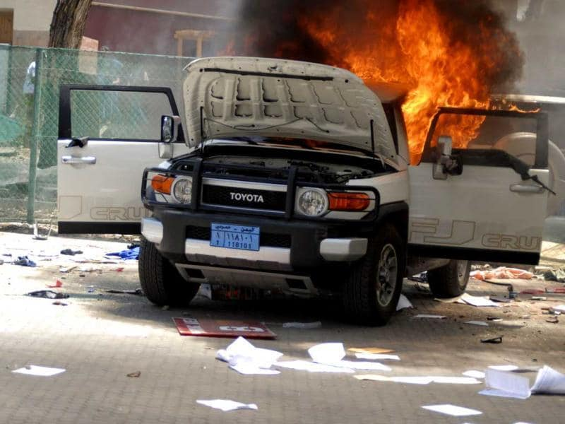 A vehicle burns at the US embassy in Sanaa. Reuters/Mohamed al-Sayaghi