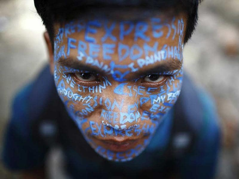 An artist with his face painted participates in a protest demanding the safety of artist Manish Harijan and his freedom of expression, near the Kathmandu District Administration Office (DAO) in Kathmandu.(Reuters)