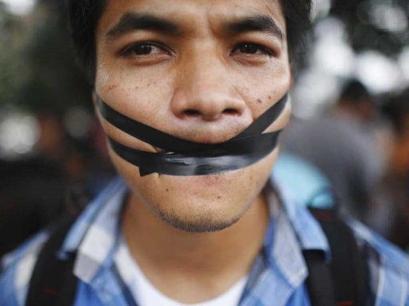 An artist, with his lips sealed with tape, protests demanding the safety of artist Manish Harijan and his freedom of expression, near the Kathmandu District Administration Office (DAO) in Kathmandu. According to the local media, the protest was organized by Nepalese artists because of the death threat received by Harijan for creating and exhibiting paintings depicting Hindu gods blended into images of western superheroes like Ghost Rider and Superman. (Reuters)