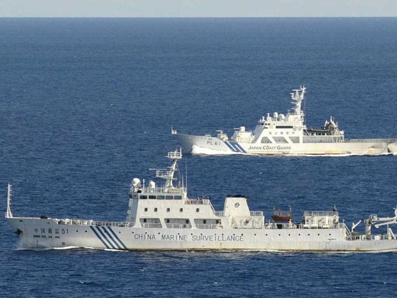 The Chinese surveillance ship Haijian No 51, front, sails ahead of a Japan Coast Guard vessel in waters near disputed islands, called Senkaku in Japan and Diaoyu in China, in the East China Sea. AP Photo/Kyodo News