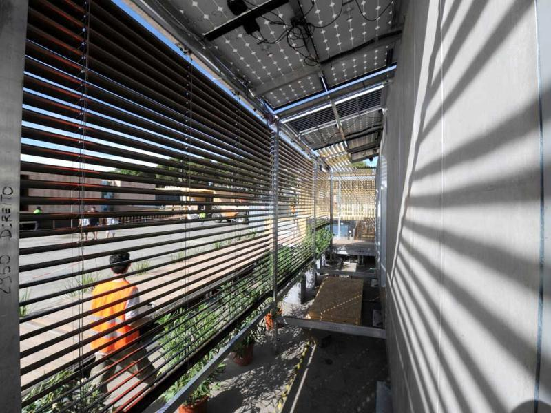 The solar house of the Brasilian university Santa Catarina of Sao Paulo is displayed in Madrid among other solar houses built and designed by 23 college and university student teams during The Solar Decathlon Europe competition in Madrid. AFP PHOTO/DOMINIQUE FAGET