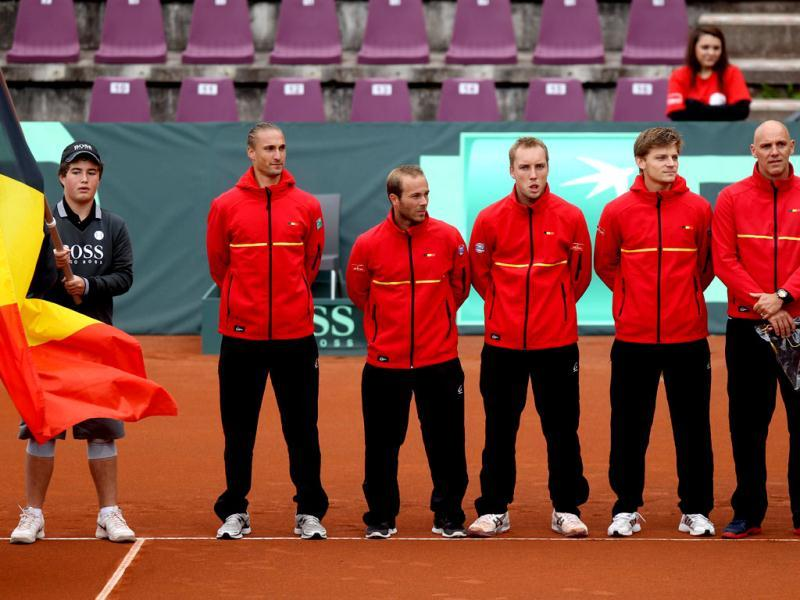 Belgian Davis Cup team players, from left, Ruben Bemelmans, Olivier Rochus, Steve Darcis, David Goffin and captain Johan Van Herck pose on September 14, 2012 before the start of the first game of the Davis Cup playoff against Sweden for the World Group at the Royal Primerose Tennis Club in Brussels. AFP Photo