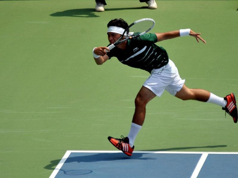 Christopher Benjamin Rungkat of Indonesia returns a shot during the final round of the men's singles Davis Cup Asia-Oceania Zone group II final match against Francis Casey Alcantara of the Philippines at Gelora Bung Karno Tennis Stadium in Jakarta on September 14, 2012. AFP Photo