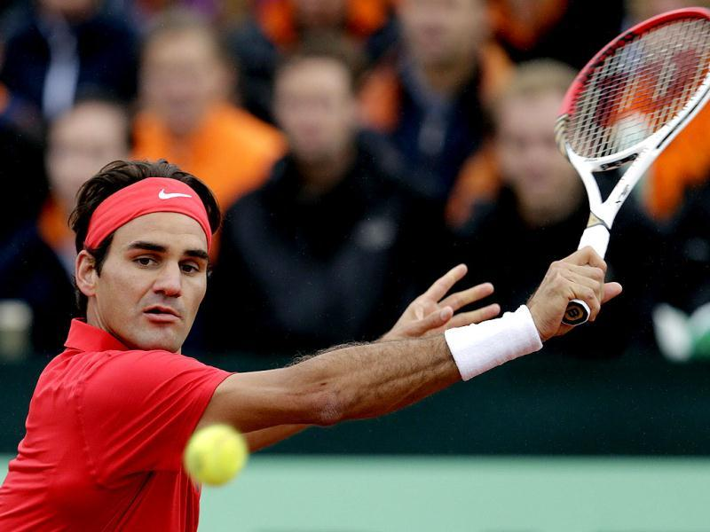 Roger Federer of Switzerland returns a ball to Thiemo de Bakker of the Netherlands, during the first single of the Davis Cup World Group Play-off round match between the Netherlands and Switzerland, in Amsterdam, Netherlands, Friday, Sept. 14, 2012. AP Photo