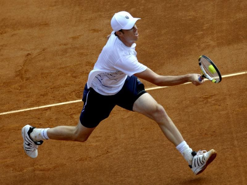 US Sam Querrey returns a ball to Spain's David Ferrer during the first match of the Davis Cup semi-final Spain vs USA at the Hermanos Castro park court in Gijon, northern Spain, on September 14, 2012. AFP Photo