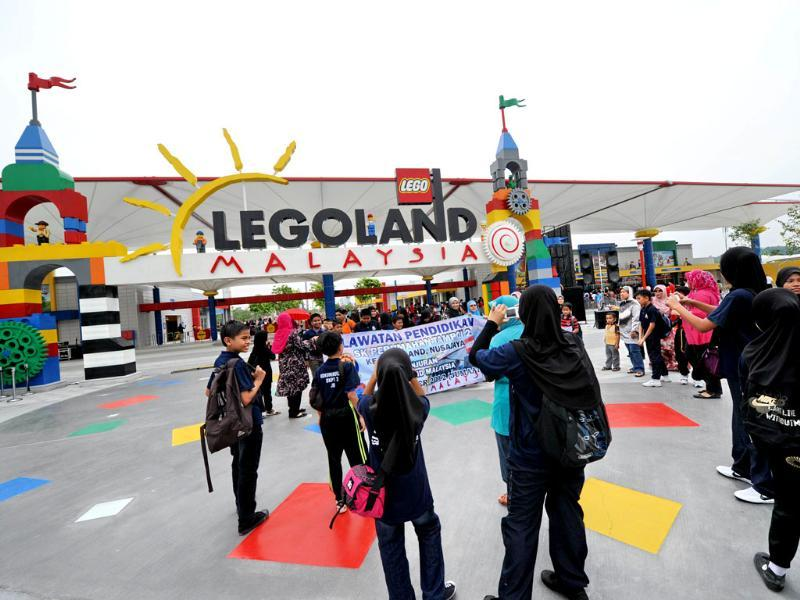 Malaysian school children pose for group photographs at the entrance ahead of the opening of Malaysia's Legoland park in Johor Bahru. AFP/Roslan Rahman