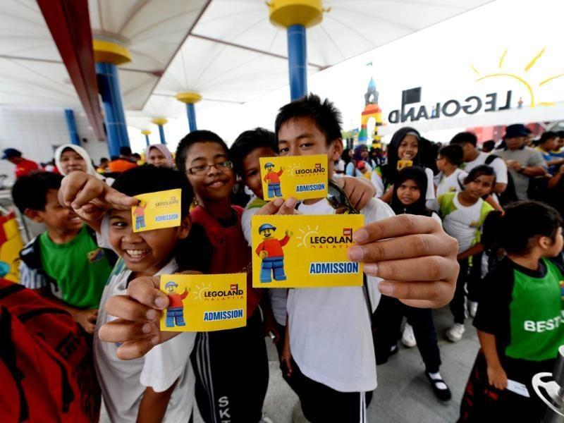 Malaysian school children display their admission tickets ahead of the opening of Malaysia's Legoland park in Johor Bahru. AFP/Roslan Rahman